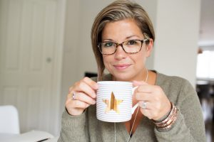 Brilliant human with mug of tea looking super clever